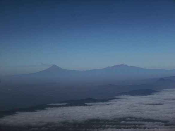 Iztaccihuatl and Popocatépetl could be seen in the distance.