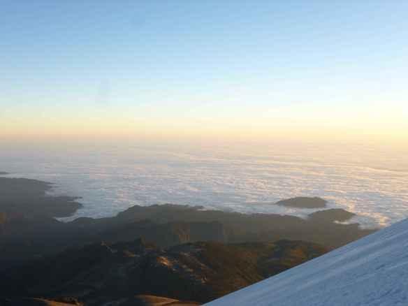 A cloud ocean far below.