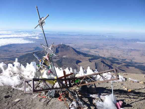 Various summit markers have been destroyed by weather, leaving a heap of junk.