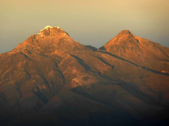 Illiniza Sur, left, and Illiniza Norte, right, from the summit of Cotopaxi at sunrise.