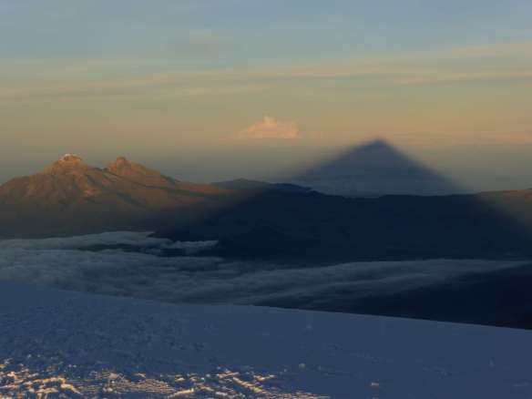 The shadow of Cotopaxi and the two Illinizas.