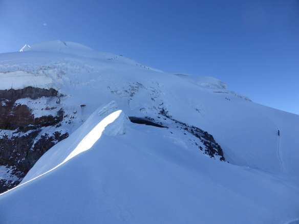 The top and crux of the route.  This image provides a good sense of scale to the sheer size of Cotopaxi.  Yanasacha is at center left.  Zoom into this photo to see the Belgian team of four descending, and four other teams still ascending.