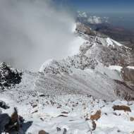 The upper Canaleta from Aconcagua's summit. Ascending climbers are visible in the middle of the frame.